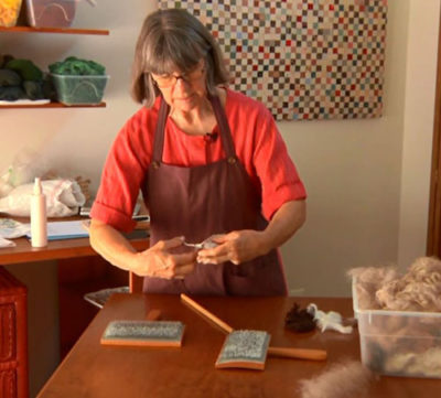 Rita Buchanan cuts her fibers.