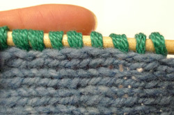 How to pick up stitches in knitting involves two steps.