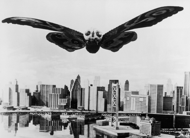 Mothra the giant moth soars menacingly over a Tokyo in a still from the Japanese film, 'Mothra,' directed by Ishiro Honda. 1961. (Photo by Hulton Archive/Getty Images).