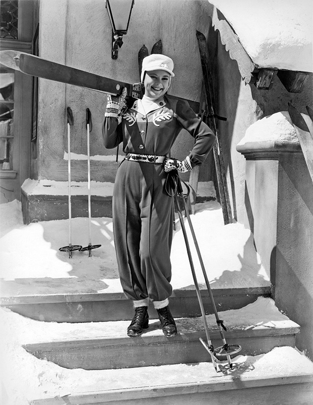 Norwegian Sonja Henie (1912–1969), Olympic and World Champion ice skater, poses with her ski gear. California. 1930s. Photograph by Underwood Archives/Getty Images.