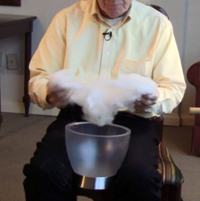Norman Kennedy massages baby oil into wool.