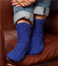 Knit Cabled Slipper Socks free pattern from Premier Yarns.