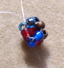 Learn how to cubic right-angle weave in this expert beading blog, step 6 includes working your beading thread up to the top of the unit and passing through the 4 beads at the top connecting them.
