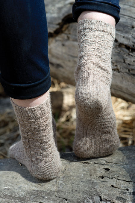 From the office to hiking, these knitted socks can take you anywhere! This sock knitting pattern is easier to knit than you think!