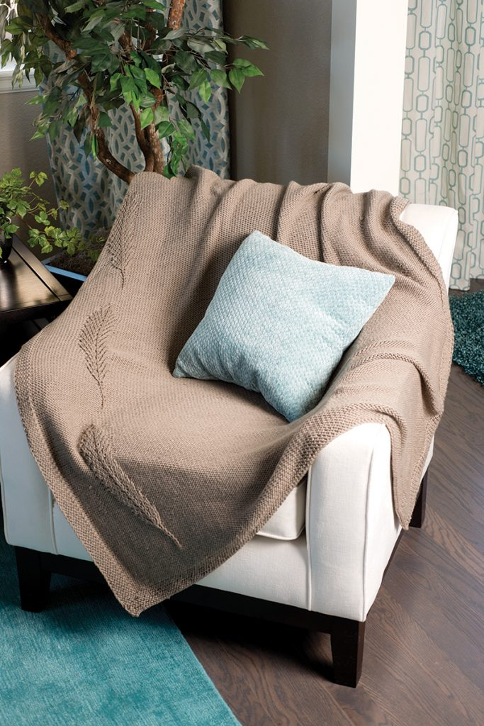 Feather Throw designed by Faye Kennington from Love of Knitting Winter 2016