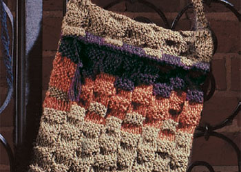Learn how to make this knitted basketweave shoulder bag in this free eBook that contains 9 free knitting bag patterns.