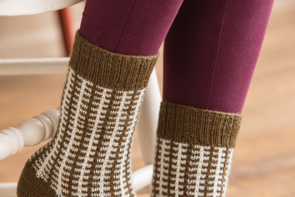 Learn how to knit socks with a simple slip-stitch pattern worked into two colors to create a faux-plaid effect!