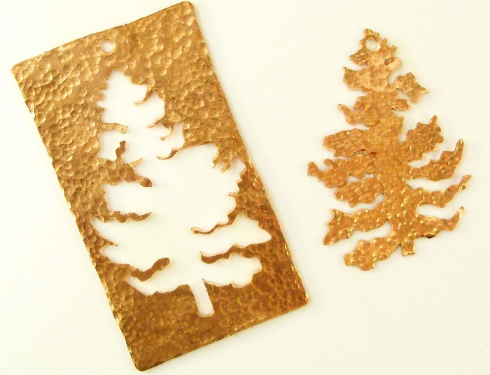 cut out copper Christmas tree ornaments, textured or enameled, by Cathleen S. Wile