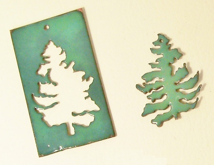 cut out copper tree ornaments, textured or enameled, by Cathleen S. Wile