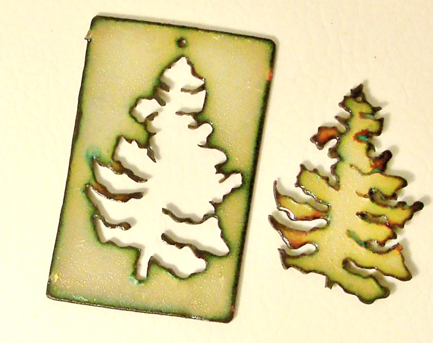 cut out and enameled copper Christmas tree ornaments by Cathleen S. Wile