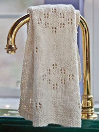 Learn everything you need to know about what 'no stitch' means in lace knitting and create beautiful knitted lace designs, such as this knitted towel.