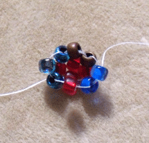 Learn how to cubic right-angle weave in this expert beading blog, step 5 includes closing up the last side unit of cubic right-angle weave by passing one bead through the third bead from the second unit, the last empty bead in the base unit and the bead you exited at the beginning of this step.