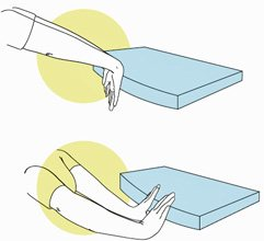 two wrist stretches: fingers pointing down, use backs of hands against table to stretch. fingers pointing up, place fingertips against table edge to stretch.