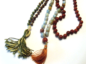 Learn how to knot gemstone beads with these expert tips and techniques. Mala beads are the perfect beaded jewelry accessory for meditation, yoga, you name it!
