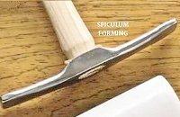 Spiculum forming hammer.