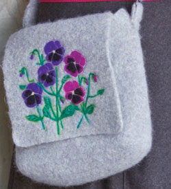 The Message in the Flower bag is a sturdy messenger bag that can be found in the Free Crochet Bag Patterns eBook.