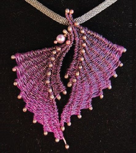 pink wire weaving pendant by Marilyn Moore, photo by Kara Saxby