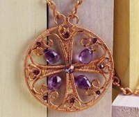 If you like wire jewelry making, then you'll LOVE the wire jewelry projects and designs in the Weave, Wrap, Coil wire jewelry making book, such as this wire jewelry design, Melonia's Cross.
