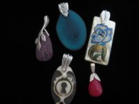 Decorative pinch bails are one way to display treasured pendants or large holed beads