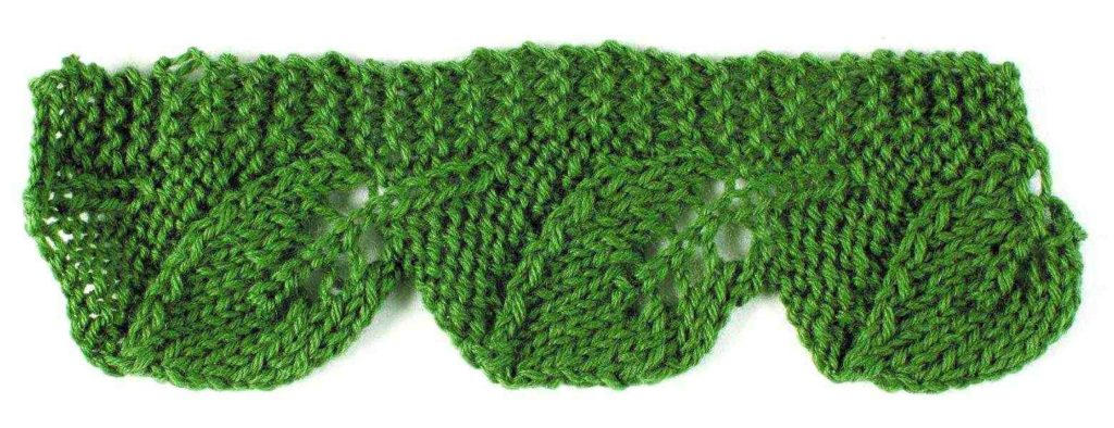 046bae0611f Vertical leaf motifs with a single garter-stitch edge can be used to attach  an edging to an existing garment