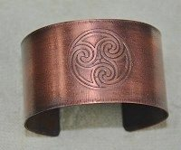 You can use liver of sulfur on copper jewelry to create beautiful micron finishing, such as this copper, Celtic bracelet design.