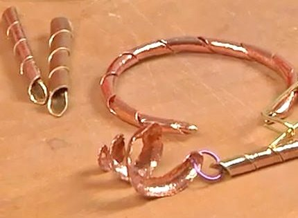 coiled and spiral tubes in metal for jewelry