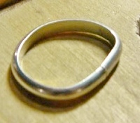 Learn how to make rings the right way with this exclusive ring-making tutorial. This step shows how to form the ring by curving the wire into an oval.
