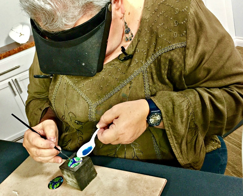 Jackie intensely concentrating in the studio making faux cloisonne jewelry
