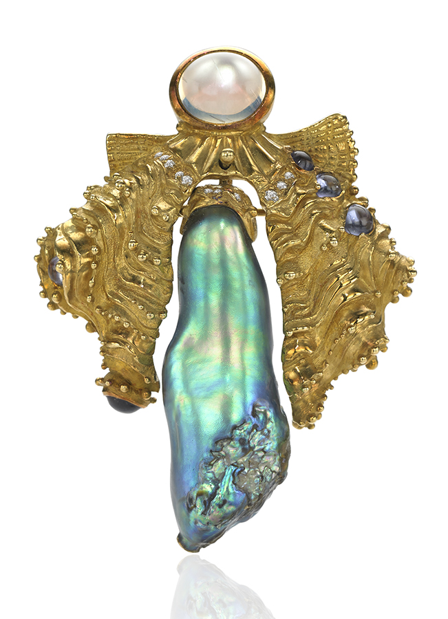 """18k yellow gold brooch/pendant, set with a 45 carat natural abalone pearl, accented with rainbow moonstone, diamonds, and tanzanite. Betty Sue King remembers just when she bought this natural Baja California pearl from Lowell Jones: It was the day of the Loma Prieta earthquake in San Francisco. She commissioned AGTA Spectrum Award-winning designer Norah Pierson to create a piece for it. """"I was completely awed by the results,"""" says King. Design by Norah Pierson. Photo by John Parrish, courtesy Betty Sue King, King's Ransom."""