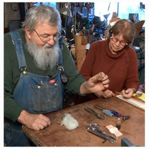 Alden Amos explains to Linda Ligon the different tools every spinner should have in their tool box.