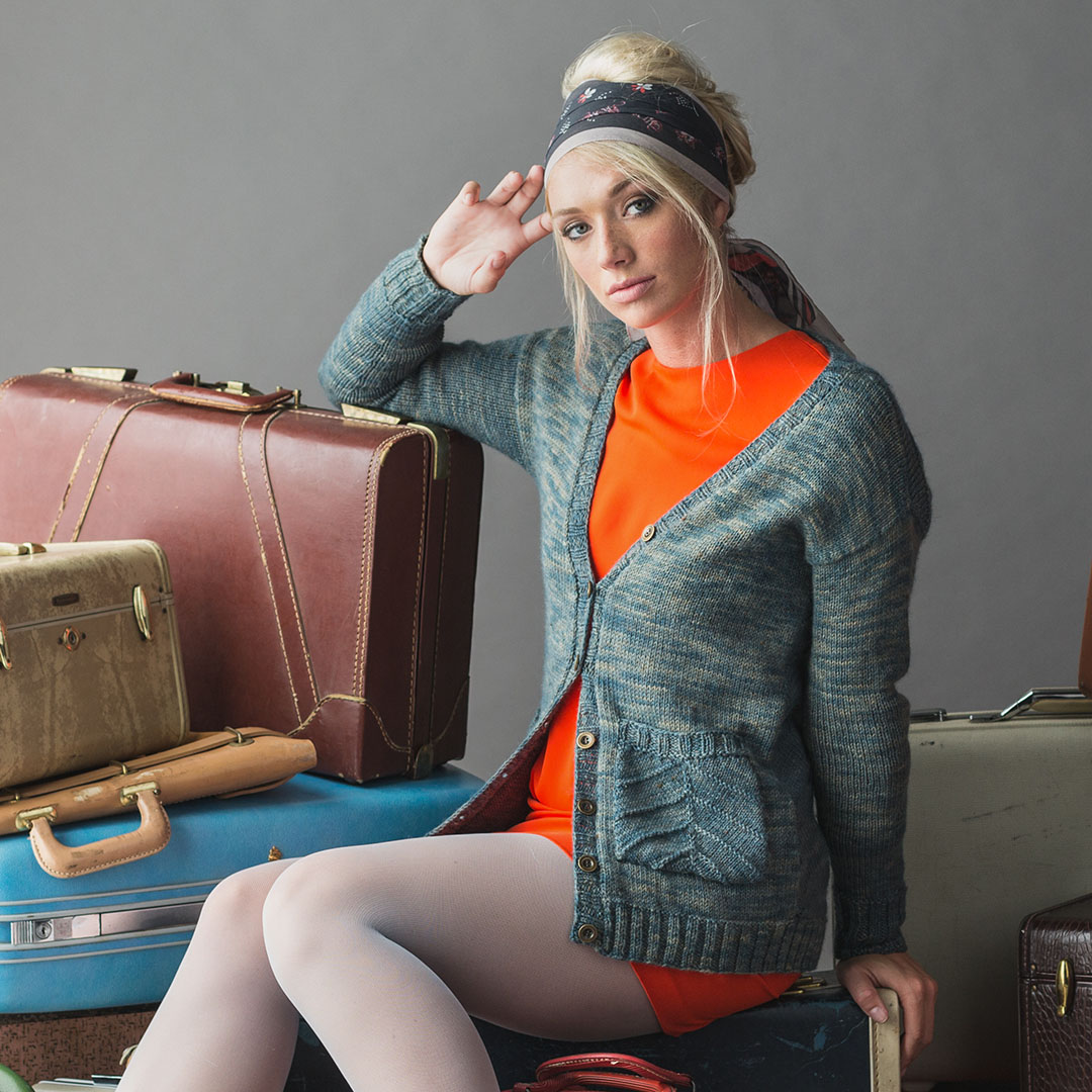 The Bi-Wing Cardigan is knit in Ancient Arts Fibre Crafts Lascaux Worsted (forever in blue jeans colorway).