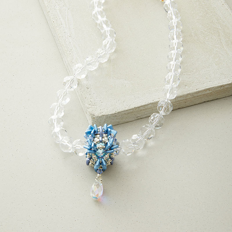 Crystal Snowflake Beaded Bead and necklace design, complete with instructions in February/Marcy 2020 Beadwork magazine