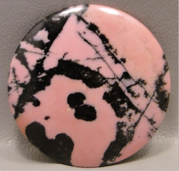 pink gemstones: The Rorschach test quality of the black patterning in this round rhodonite is anything but weak and vulnerable. Photo courtesy of Barlow's Gems.