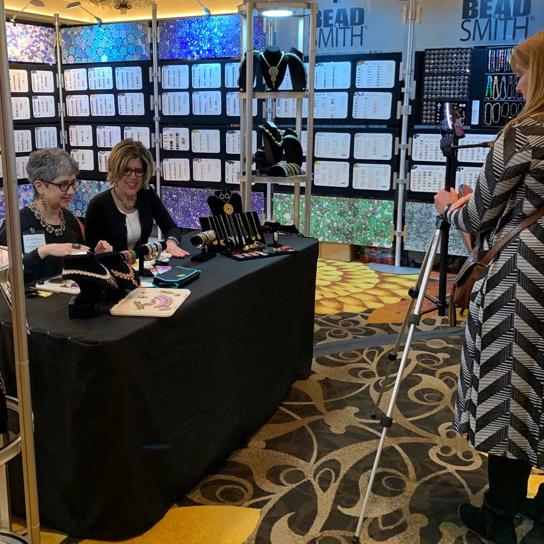 Leslie Rogalski & Tammy Honaman looking over the new product in The Bead Smith booth