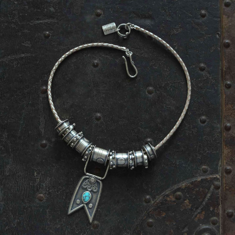 """Broken, but Better by Jessica Jordan. Sterling and Fine Silvers, Leather, Kingman Turquoise Inspiration: Spools of thread, the tying together of things, memories, and people. Also Leonard Cohen's """"Anthem."""" Forget your perfect offering. There is a crack in everything. That's how the light gets in. How long did it take you to make this piece? Approximately 6 hours."""