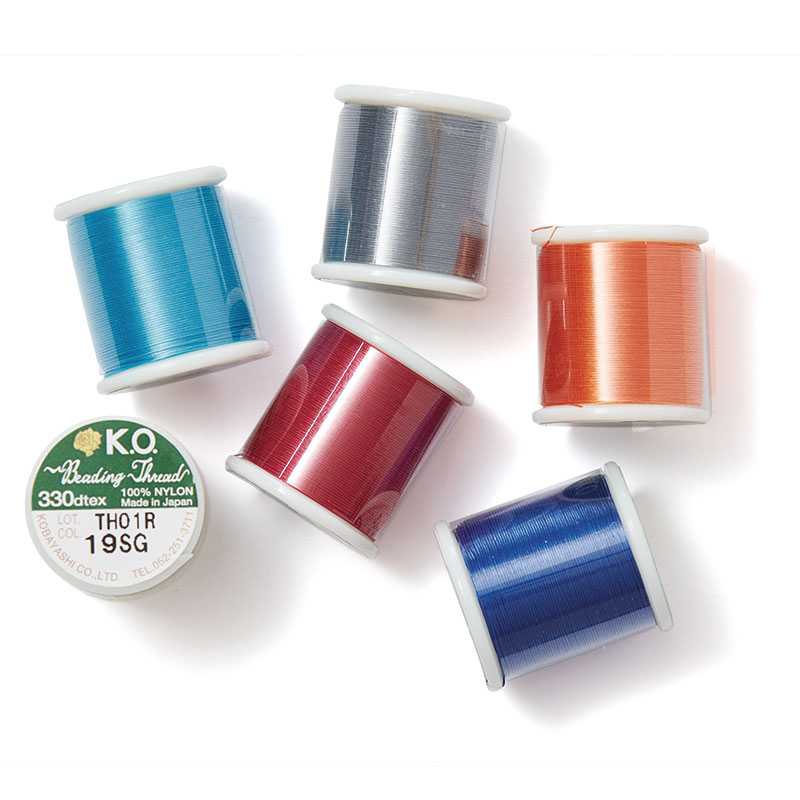 K.O. nylon beading thread is now available in orange, clear blue, dark gray, scarlet pink, smoke green, and turquoise to match any design you can dream up.