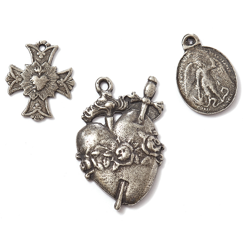 """The """"Saint"""" line of pendants and charms includes reproductions of antique medallions."""