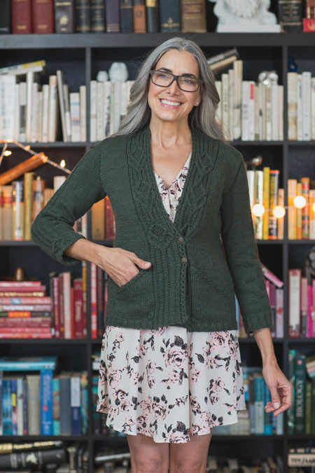 Learn how to make a knitted jacket the right way with the Caldecott Jacket knitting pattern that's an A-line cardigan with cable front bands that wrap along the back neck to form the collar.
