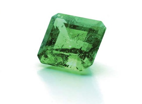 Faceted emerald This Colombian emerald has small, jagged three-phase inclusions consisting of liquid, gas bubble with crystal element (commonly pyrite).