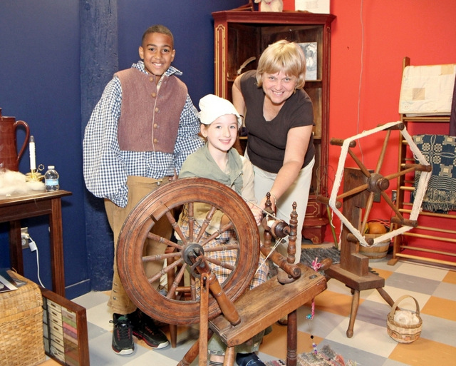 The museum holds a large collection of antique spinning wheels. Photo courtesy of the American Textile History Museum, Lowell, Massachusetts.