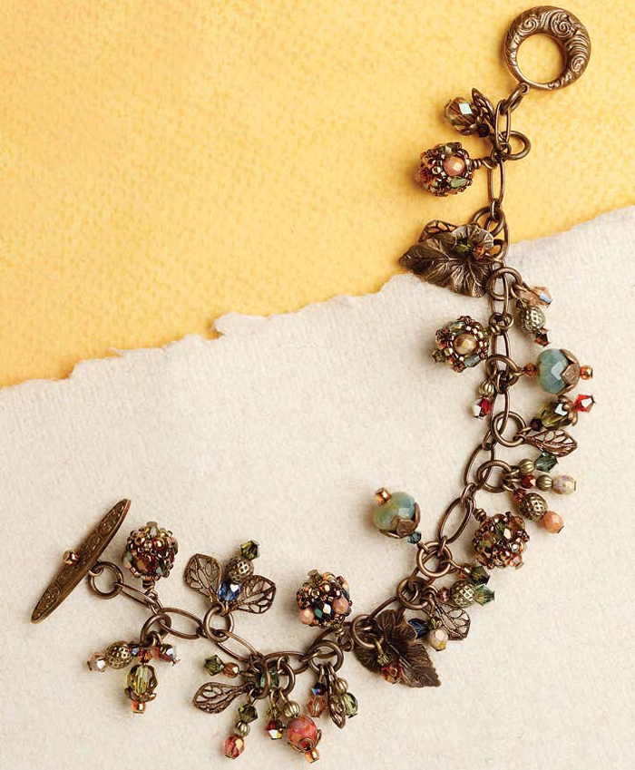 Make this right-angle weave charm bracelet with brass findings, beads and chain in this free right-angle weave pattern.