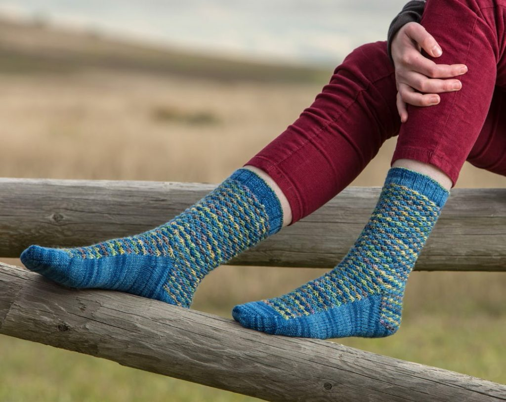 Use your variegated sock yarn in the pretty Daisy Field sock knitting pattern!