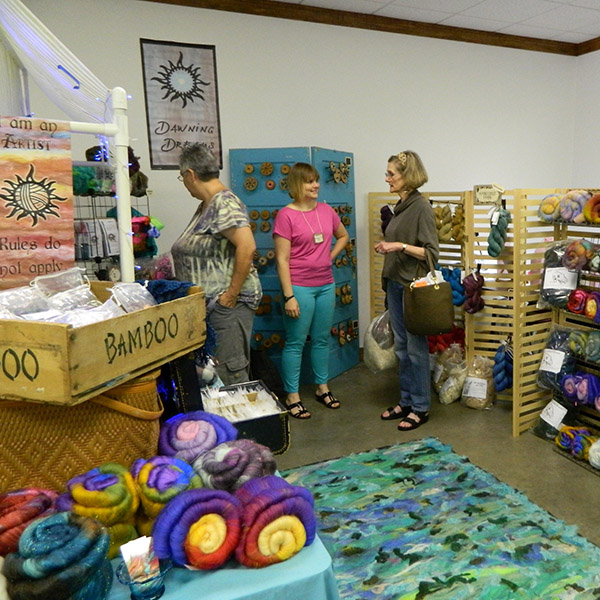 Fiber Christmas in July: Visit Dawn Riden's booth and explore how rewarding spinning is! Photo by Kate Lowder