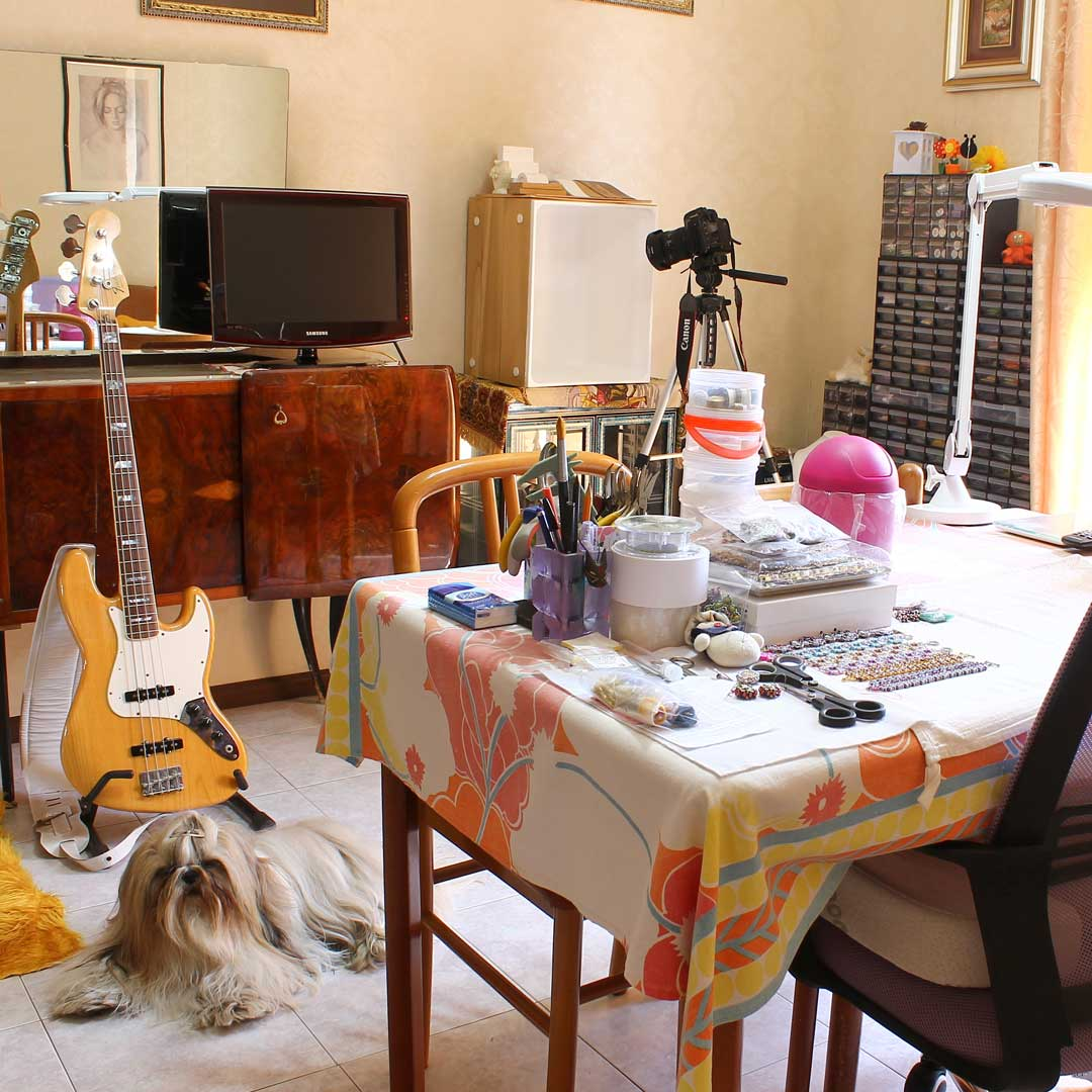 Debora Hodoyer uses her dining room for beading and doing guitar maintenance. Her dog, Sharden, is Debora's number one fan. (Photo courtesy of Debora Hodoyer)