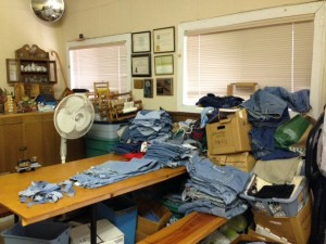 Charley's pile of denim ready to be made in rags for rag rugs.