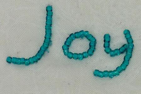 beaded text embroidery