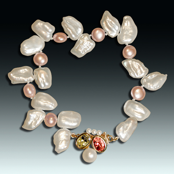 "This freshwater pearl bracelet, ""Nightlife II,"" combining white and peach pearls of different shapes, shows just how varied pearls are. Accented with round white Akoya pearls, an oval peridot, an oval pink tourmaline, and a 14k yellow gold clasp. Photo by Matthew Arden, courtesy Eve J. Alfillé Gallery & Studio, Evanston, Illinois."