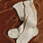 Evening Stockings for a Young Lady to Knit by Nancy Bush, featured in Piecework November/December 2009