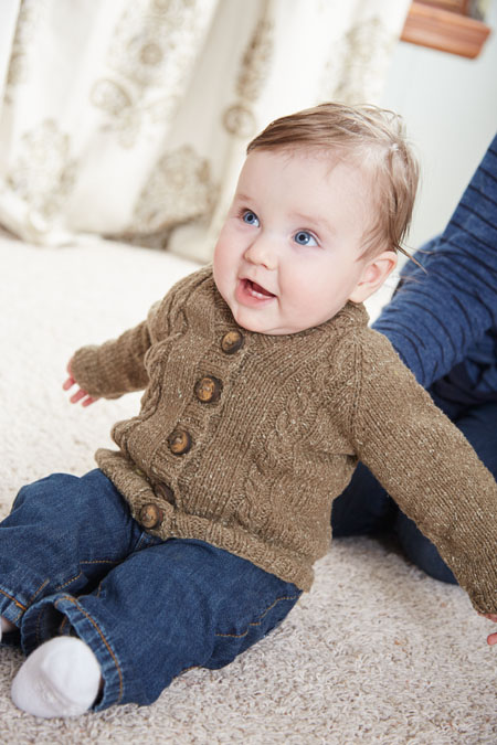 You'll love knitting this bottom-up, simple, and seamless knitted swear that's perfect for baby that includes buttons and warmth!