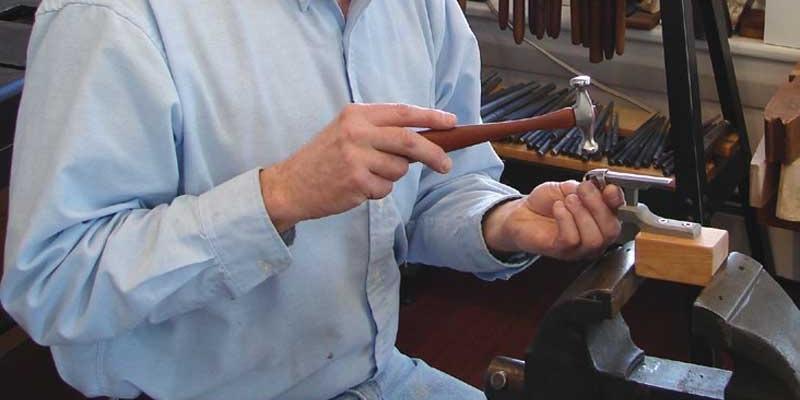 Bill Fretz hammers hammering metalsmithing